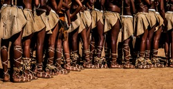 Legs of Young Botswana Female Traditional Dance Group Parading In Traditional Leather Attire, Sandals and Leg Rattles Popularly Worn By The San.