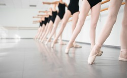 legs of young dancers ballerinas in class classical dance, ballet