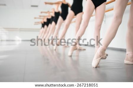 legs of young dancers ballerinas in class classical dance, ballet Foto stock ©