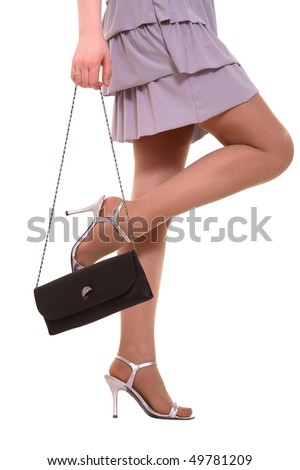 legs on high heels and black purse over white