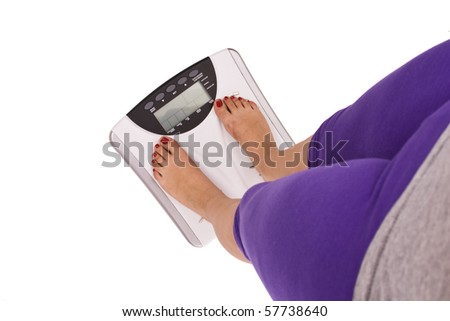 legs on scales isolated in white background