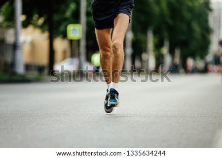 legs runner men running street marathon race #1335634244