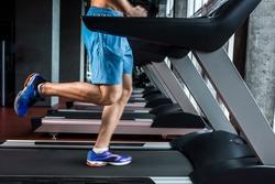 Legs running on the treadmill close up