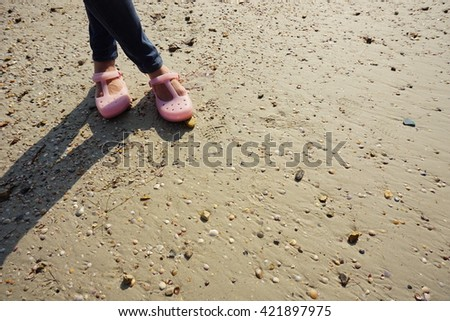Legs stand at the beach, left of frame. Relax on free time. #421897975