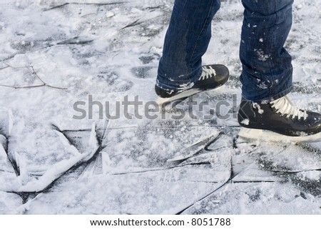 legs with skates on outdoor natural ice