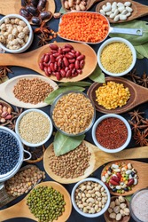 Legumes pulses background. Legumes variety flat lay. Pulses and herbs dried uncooked composition top view