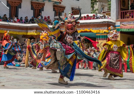 Leh, India - June 21, 2017: Unidentified monks in mask performing a religious masked and costumed mystery dance of Tibetan Buddhism during the Buddhist festival at Hemis monastery, Ladakh. #1100463416