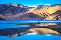 Leh, Ladakh,  India-June 8 2017: Landscape with reflections of the mountains on the  lake named Pagong Tso, situated on the border with India and China.