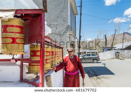 Leh, Ladakh, Kashmir India, May 6th, 2017:  A Tibetan man playing the prayer wheel at the  Street of Leh City, Ladakh, district of Kashmir, India  #681679702