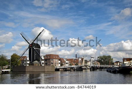 Leiden- draw bridge and windmill on a sunny day in The Netherlands