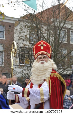 LEIDSCHENDAM, THE NETHERLANDS-NOVEMBER 13, 2010: Sinterklaas is greeting people while walking in the streets of Leidschendam the Netherlands. November 13, 2010 Leidschendam, The Netherlands