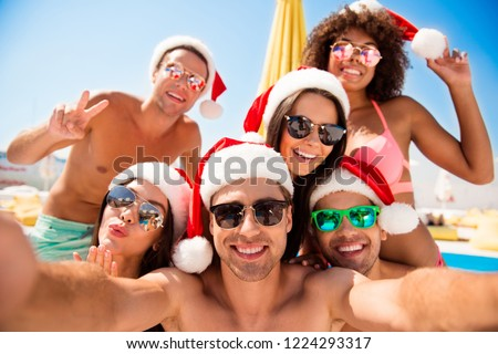 Leisure lifestyle trip trevel sea resort concept. Glad rejoice positive beautiful attractive pretty diversity people in cap hat headwear and stylish spectacles make video-call or picture on cellular