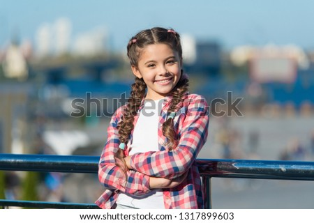 Leisure options. Free time and leisure. Girl cute kid with braids relaxing urban background defocused. Organize activities for teenagers. Vacation and leisure. What do on holidays. Sunny day walk.