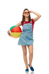 leisure, summer holidays and people concept - smiling teenage girl in sunglasses with beach ball over white background