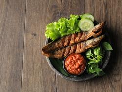 Lele Goreng or Fried Catfish is Traditional Indonesian Culinary Food. Catfish and Chilli Tomato Paste, Popular Street Food Called Pecel Lele Lamongan or Penyetan Lele