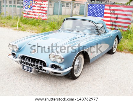 stock-photo-lelystad-june-chevrolet-corvette-convertible-is-on-display-at-the-annual-national-143762977.jpg