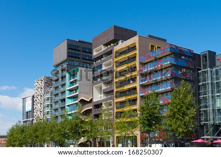 LELYSTAD, NETHERLANDS - AUGUST 31: Zilverparkkade (Silver Park Quay) on august 31, 2013 in lelystad, netherlands. It's a series of office and apartment buildings of varying height on modest size lots.