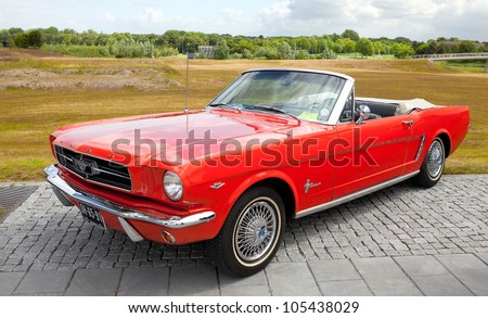 LELYSTAD, THE NETHERLANDS - JUNE 17: A 1965 Ford Mustang Convertible on display at the annual National Oldtimer day on June 17, 2012 in Lelystad, The Netherlands