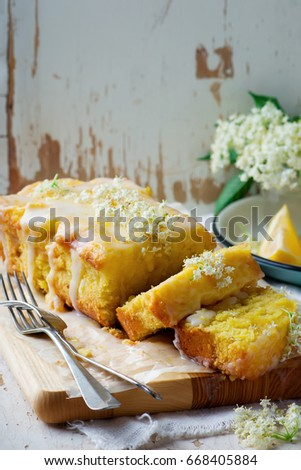 LEMON  and ELDERFLOWER DRIZZLE CAKE.vintage style.selective focus