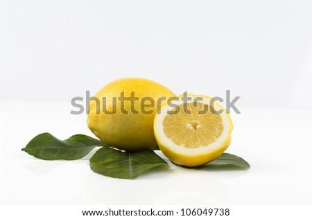 lemon and half a lemon on white background