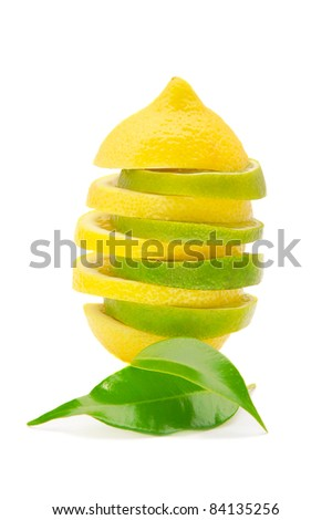 lemon and lime pyramid with leaves isolated on white background