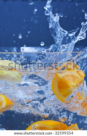 lemon and orange splashing on fresh water