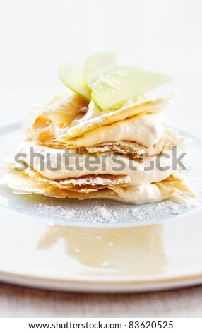 Lemon and vanilla cream cake dessert decorated with apple slices (shallow dof)
