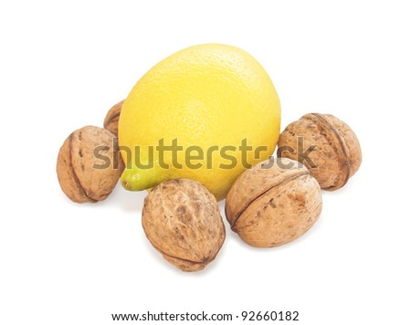 Lemon and walnut on white background