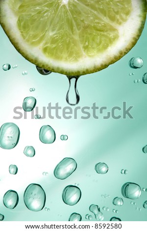 Lemon and water drops - stock photo