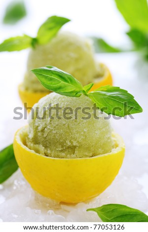 lemon- basil sorbet in cups of lemon