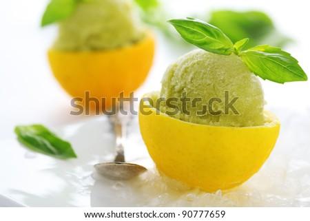 lemon- basil sorbet in cups of lemon