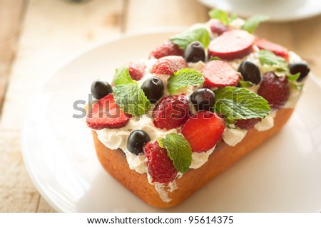 Lemon Cake topped with whipped cream, fresh fruits and mint 8