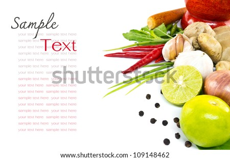 Lemon, chili ,garlic, pepper, ginger, shallot chive and holy basil leaves with wooden mortar - stock photo