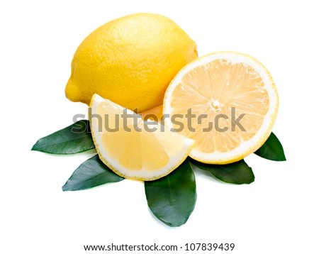 Lemon citrus with cut and green leaves isolated on white.
