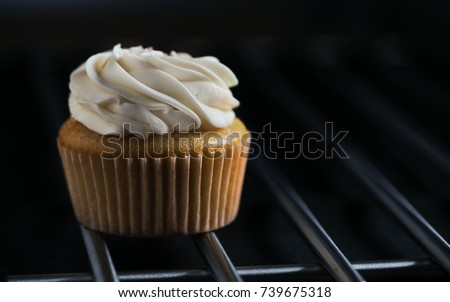 Lemon cupcake with cream on a grill  #739675318