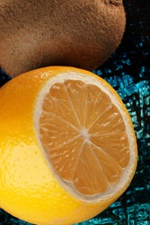 Lemon cut close-up with kiwi lies on a glass vase citrus background macro photography