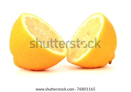 lemon cut into two parts on white