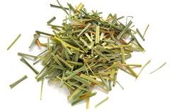 Lemon Grass (Cymbopogon citratus, Capim Limao, Santo). Pile of dried Lemongrass. Dried sprigs of natural lemongrass, dried herb, herbal medicine. Selective focus, closeup