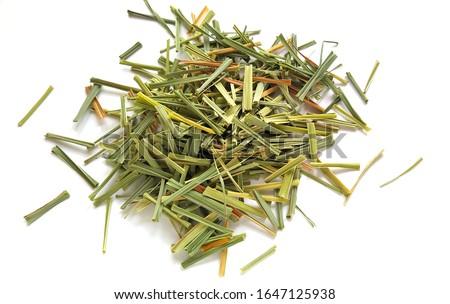 Lemon Grass (Cymbopogon citratus, Capim Limao, Santo). Pile of dried Lemongrass. Dried sprigs of natural lemongrass, dried herb, herbal medicine. Selective focus, closeup Сток-фото ©