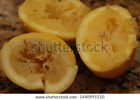 Lemon Halves that Have Been Squeezed on a Kitchen Counter