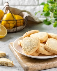 Lemon Heart cookies in a white plate on the light gray kitchen table. Cookies for Valentine's Day