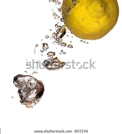 Lemon in the flight surrounded and followed by water bubbles; isolated on white background; copy space provided.