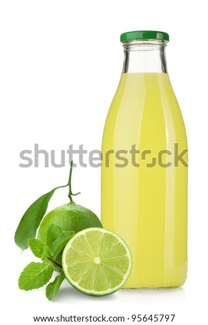 Lemon juice glass bottle, ripe limes and mint. Isolated on white background