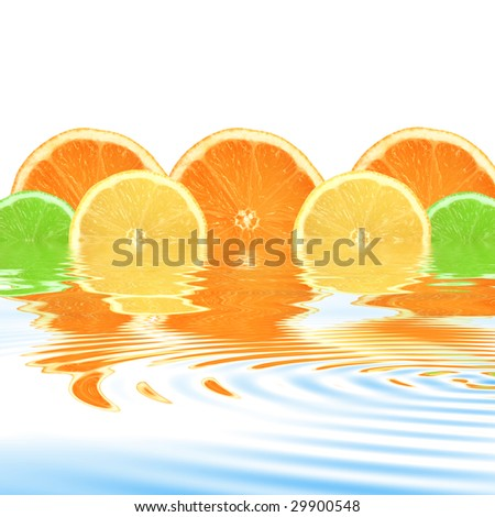 Lemon, lime and orange citrus fruit slices with reflection in rippled water, over white background.