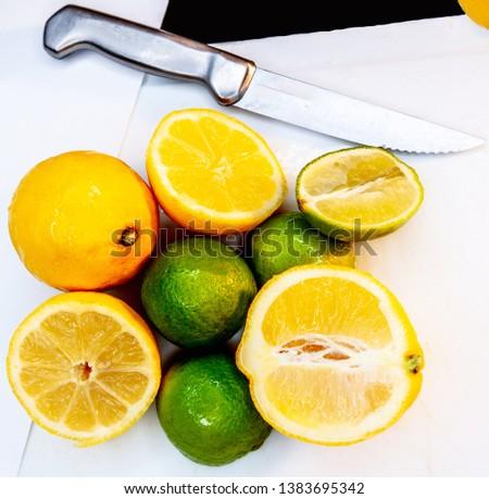 lemon lime lines sharp knife edged clean edges zest citrus fruit food white silver
