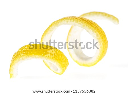 Photo of  Lemon peel on a white background, close-up. Lemon twist.