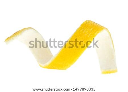Lemon peel or lemon twist on a white background. Lemon peel curl isolated.