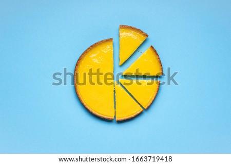 Lemon pie sliced on a blue background. Sliced lemon tart. Delicious sweet food.