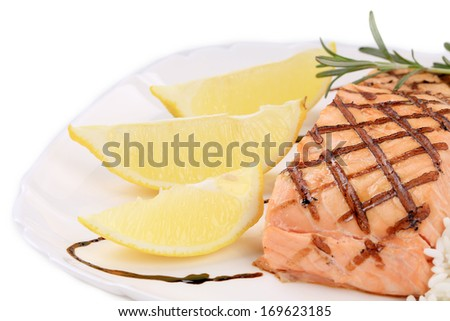 Lemon slices and salmon fillet. Whole background.