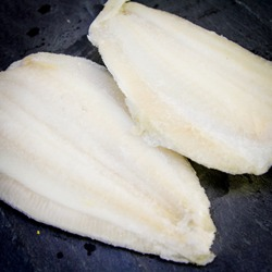 Lemon Sole Fillet of fish on a black slate